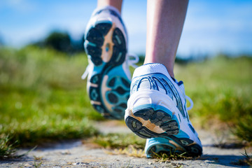 close up details of feet running shoes in action outdoor