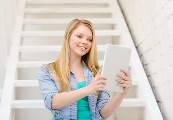 smiling female student with tablet pc computer
