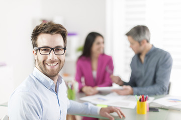 Portrait of a smiling businessman  in meeting