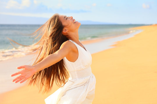 Free happy woman on beach