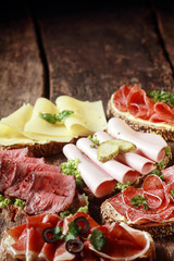 Assorted meat and cheese sandwiches