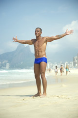 Smiling Athletic Brazilian Man Arms Spread on Beach