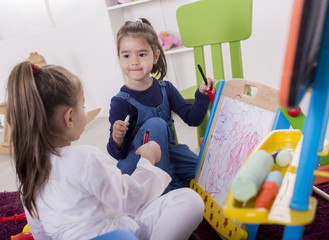 Little girls draw in the room