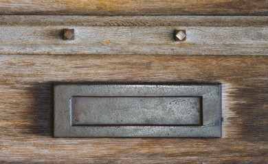 Mail slot letterbox in an old wooden door