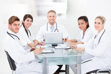 Confident Doctors At Desk