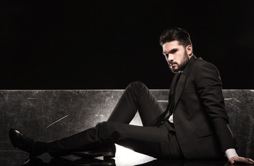 sexy business man resting on the floor