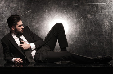 side view of a dramatic business man on the floor