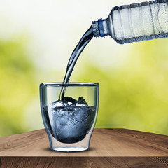 Water Bottle pouring into Glass