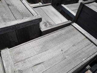 Wooden boxes at a harbor