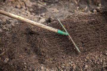 photo of garden rake on bed
