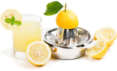 lemon juice, squeezer and fruits