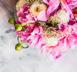 Peonies on rustic wooden background