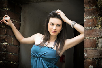 Elegant attractive young woman on threshold