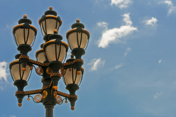 Street lamp with ornament