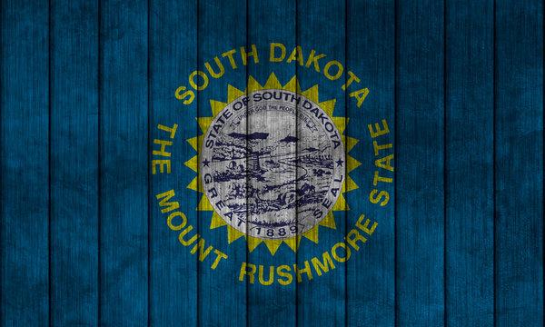 Flag in map on grunge background - South Dakota