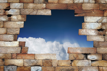 Stone brick wall with hole though the sky