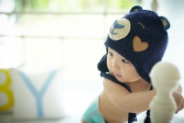 Baby with blue bear hood