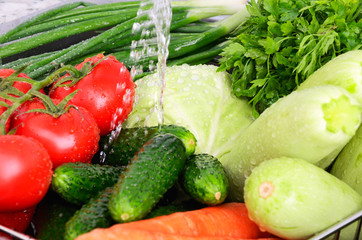 vegetables under running water horizontal closeup 0729