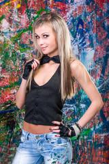 girl standing in front of art graffiti