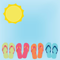 flip flops or sandals on blue sky background and sun