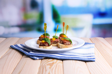 Fototapete - Tasty canapes with salami, pepper  and basil leaves,