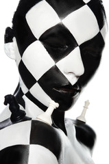Portrait with chess makeup and pieces