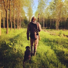Man hunting with dog