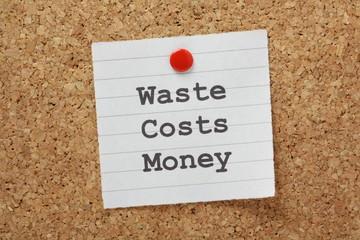 Waste Costs Money  reminder on a cork notice board