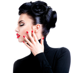 Beautiful young woman with hand near face