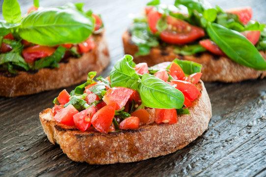 Italian tomato bruschetta with chopped vegetables