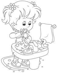 girl cleaning teeth in a bathroom