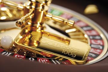 Goldbarren auf Roulettekessel