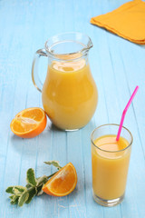 Glass and jug of orange juice