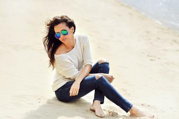 Fashion portrait of beautiful woman in sunglasses