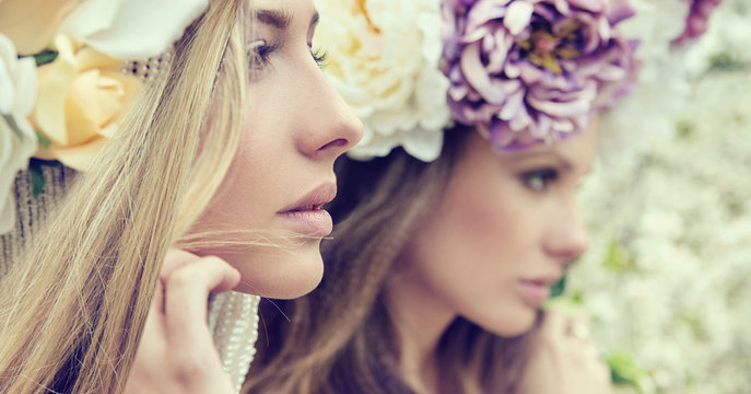 Portrait of the two gorgeous ladies with flowers