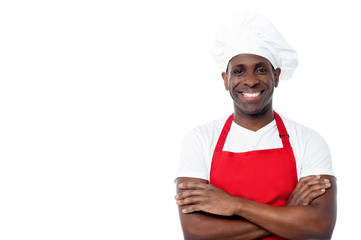 Cheerful male chef isolated on white
