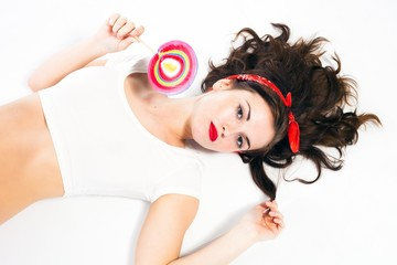 Pretty sexy pin up girl with lollipop