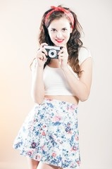 Pretty pin up girl and vintage camera