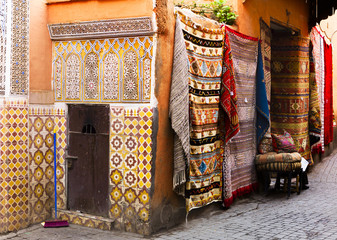 Antique carpets and tiled wall in Marrakesh