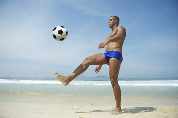 Athletic Young Brazilian Man Kicking Football Rio Beach