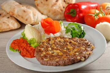 Presliced traditional burger patty called pljeskavica