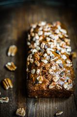 Homemade nut cake on wooden background