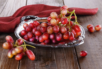 Red grapes on a vintage tray