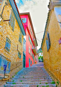 Narow road with old buildings in Nafplio town in Greece
