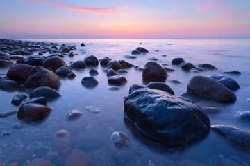 Beautiful stones in the ocean. The Baltic Sea coast, Poland.