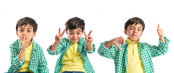 Kid doing silence gesture, victory sign and good-bad gesture