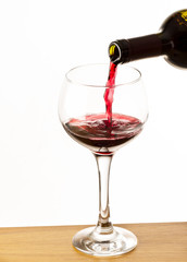 glass of red wine on the wooden table