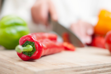chef cutting red pepper