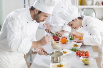 Portrait of a female chef preparing a dish carefully