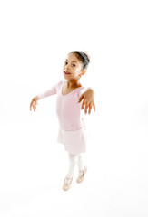 young cute ballet dancer girl isolated on white background